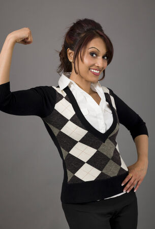 only the biceps: Indian businesswoman flexing biceps and smiling Stock Photo