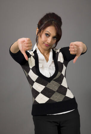 Unhappy businesswoman giving thumbs down gesture photo