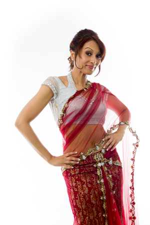 arms akimbo: Young Indian woman standing with her arms akimbo Stock Photo