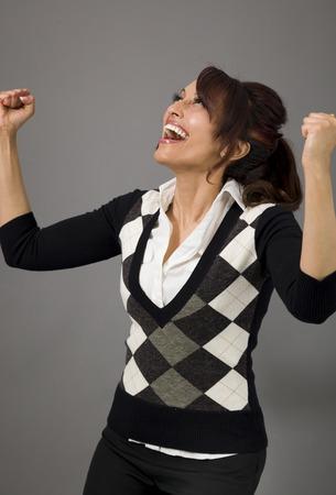 Indian businesswoman celebrating success Stok Fotoğraf