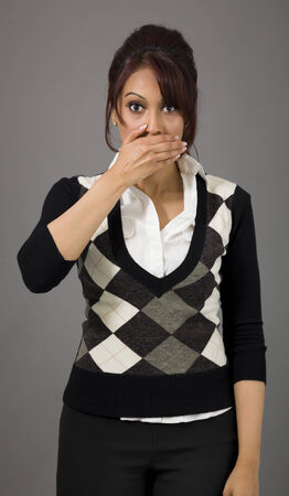 Indian businesswoman with hand over her mouth photo