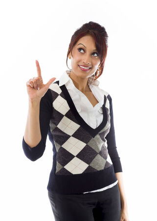 Indian businesswoman smiling and pointing upwards photo