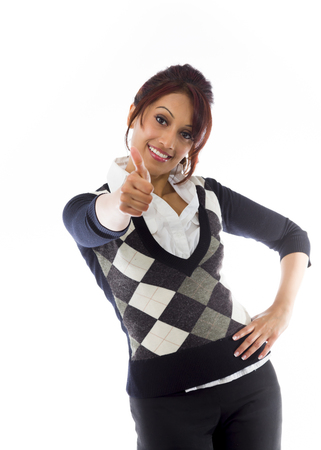 Indian businesswoman making thumbs up sign standing with hand on hip photo