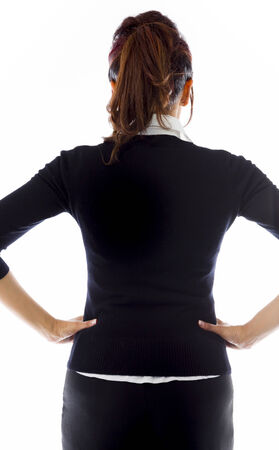arms akimbo: Rear view of Indian businesswoman standing with her arms akimbo