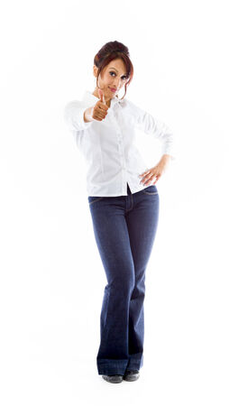Indian young woman making thumbs up sign standing with hand on hip photo