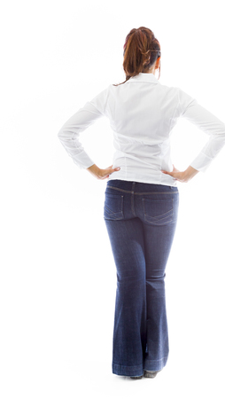 Rear view of an Indian young woman standing with hands on hip