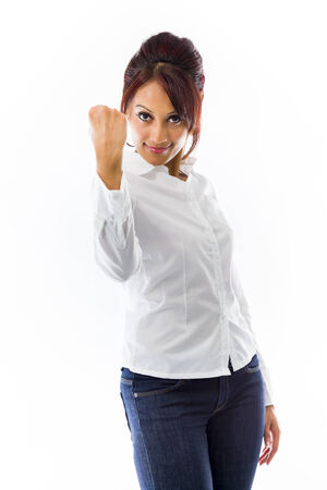 Indian young woman showing fist isolated on white background photo