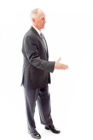 businessman standing: Businessman offering hand for handshake