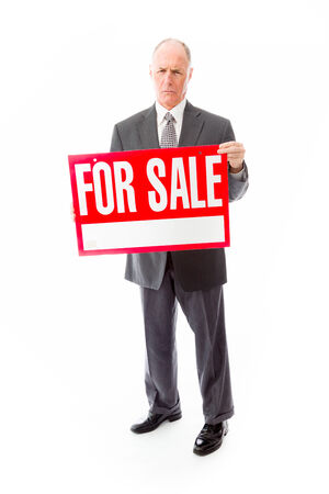 Businessman showing a for sale sign photo