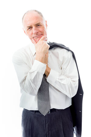 Businessman standing with hand on chin photo