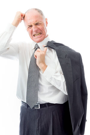 Businessman pulling his hair and screaming in frustration photo