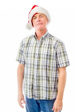 wearing santa hat: Senior man wearing Santa hat and smiling