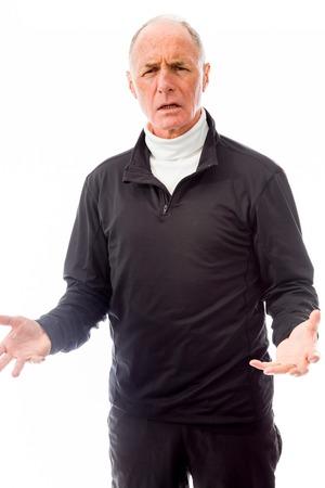 Senior man shrugging with raised hands Stock Photo