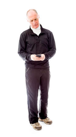 Senior man text messaging on a mobile phone photo