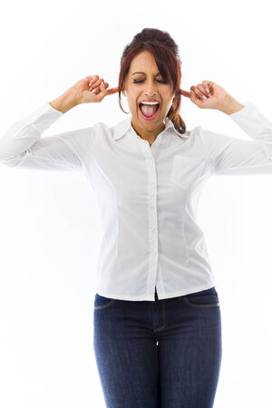 Indian young woman screaming with fingers in ear photo