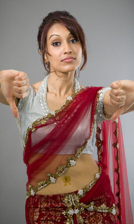 Young Indian woman showing thumbs down sign from both hands photo