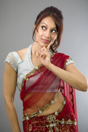 looking sideways: Young Indian woman looking sideways and thinking Stock Photo
