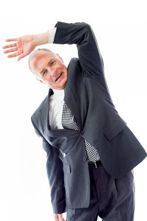Businessman stretching and smiling photo
