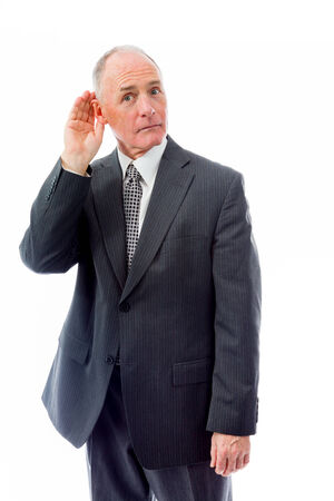 Businessman trying to listen isolated on white background photo