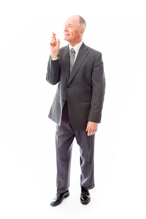 finger crossed: Businessman standing with finger crossed for luck