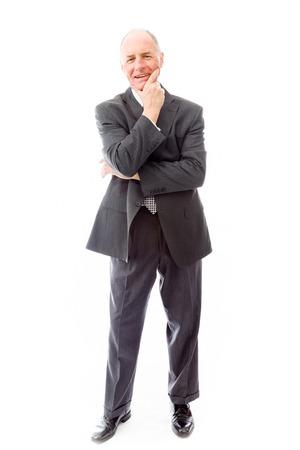 businessman standing: Businessman standing with hand on chin