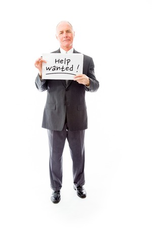 Businessman holding a message board with the text words Help wanted photo