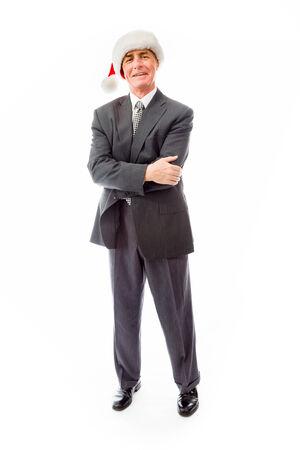 wearing santa hat: Businessman wearing Santa hat and smiling Stock Photo