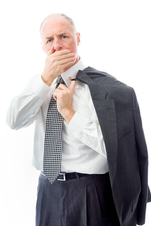 Businessman with hand over his mouth photo