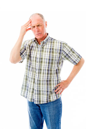 Senior man suffering from headache photo