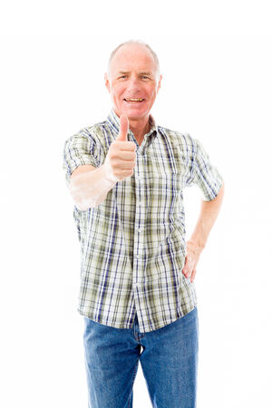 one senior man only: Senior man showing thumbs up gesture Stock Photo