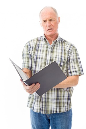 年配の男性がファイルをチェック 写真素材