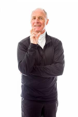 finger crossed: Senior man standing with finger crossed for luck