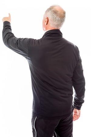 Rear view of a senior man blaming somebody Stock Photo