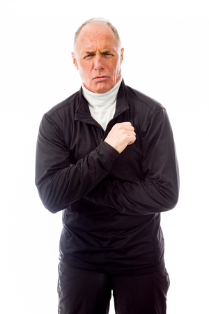 Senior man shivering in the cold isolated on white background Stock Photo