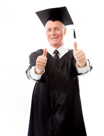 Senior male graduate making thumbs up gesture with both hands photo