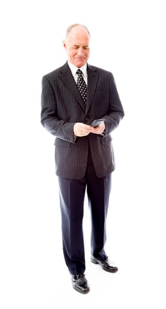 Businessman text messaging on a mobile phone photo