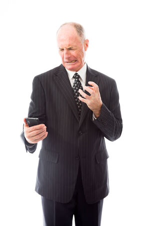 Angry businessman shouting on a mobile phone photo