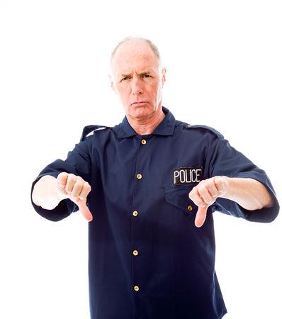 Policeman making thumbs down gesture photo