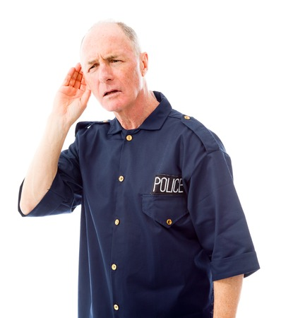 Policeman trying to listen photo