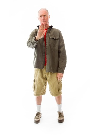 Senior man stopping with hand gesture Stock Photo