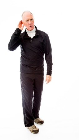 Senior man trying to listen isolated on white background photo