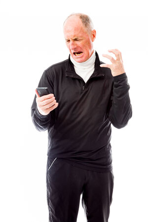Angry senior man shouting on a mobile phone photo