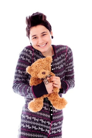 Young woman holding teddy bear and smiling photo