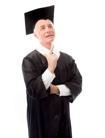 Senior male graduate looking and pointing upward photo