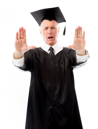 Senior male graduate holding his hand and yelling stop