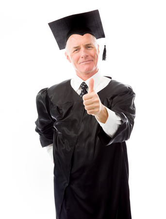 Portrait of a senior male graduate making thumbs up sign photo