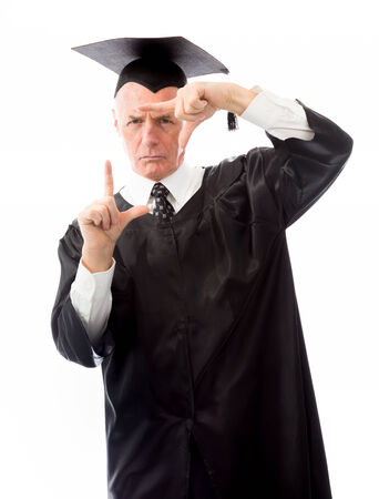 Senior male graduate framing face with fingers photo