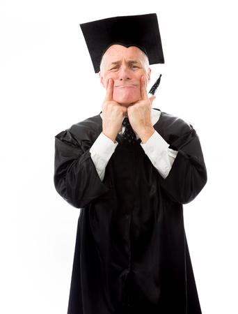 Senior male graduate pulling funny face photo