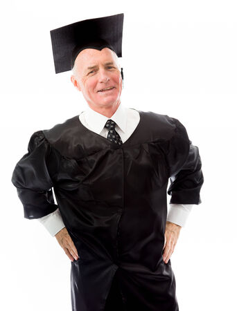 arms akimbo: Senior male graduate standing with his arms akimbo
