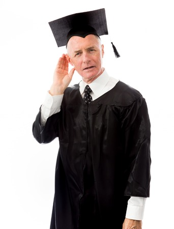 Senior male graduate trying to listen isolated on white background photo